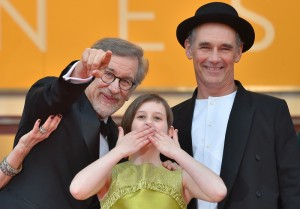 "US director Steven Spielberg, US actress Ruby Barnhill and British actor Mark Rylance cheer on May 14, 2016 as they arrive for the screening of the film ""The BFG"" at the 69th Cannes Film Festival in Cannes, southern France.  / AFP PHOTO / LOIC VENANCE"