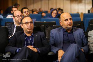 از راست مسعود نجفی و رئیسی