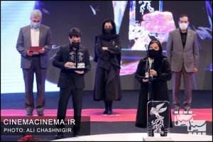 تهمینه بهرام و ارسلان امیری در مراسم اختتامیه سی و نهمین جشنواره فیلم فجر