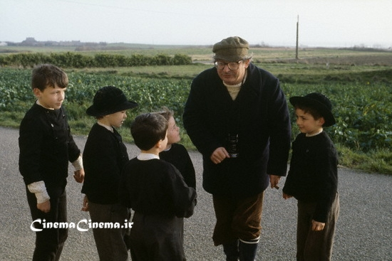 "March 1980, Benodet, France --- French director Claude Chabrol directing children on the set of his film ""Le Cheval d'Orgueil"", (""The Horse of Pride""), based on Pierre-Jakez Helias's novel by the same title"