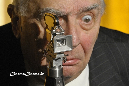 ۰۸ Feb 2009, Berlin, Germany --- French director Claude Chabrol grimaces behind his 'Berlinale Camera' award during the 59th Berlin International Film Festival in Berlin